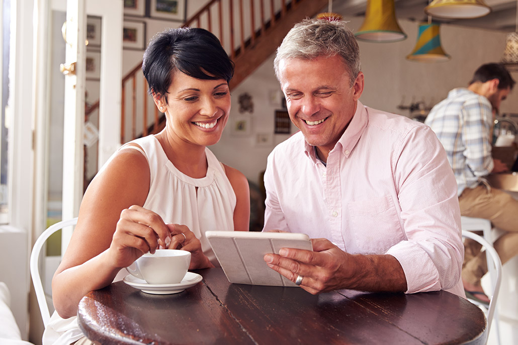 An Image Of A Couple At A Coffee Shop Looking At A Tablet For Best Fixed Annuities Plan Put On By Secure Money Advisors In Pittsburgh